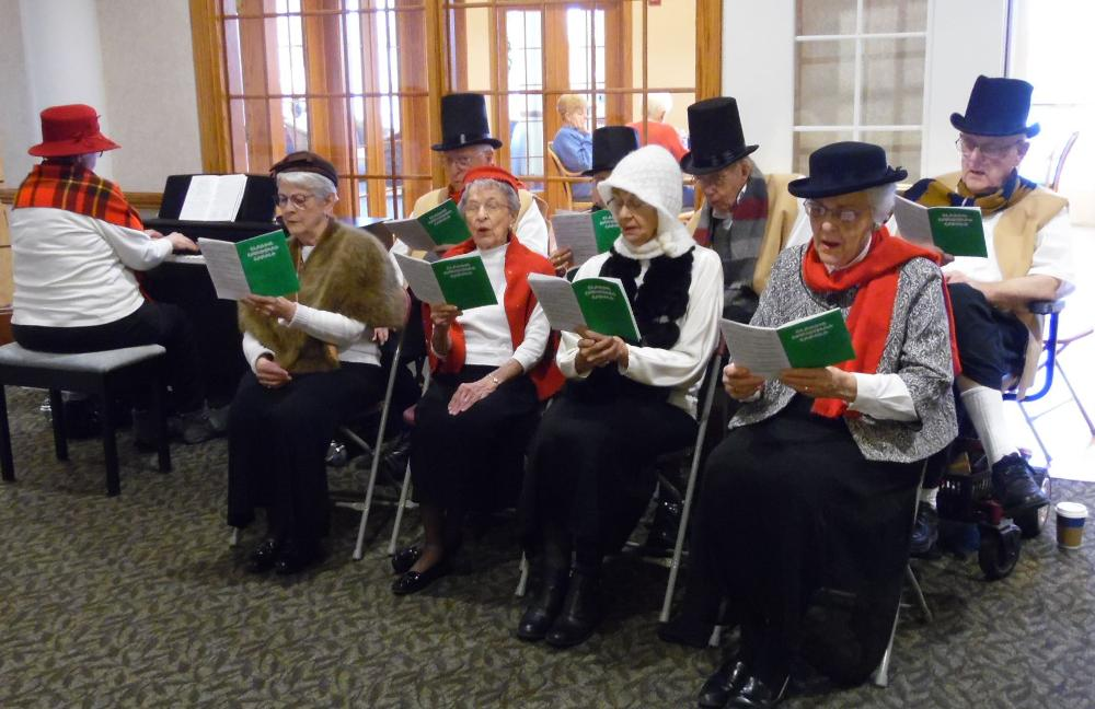 Residents from The Landing, an Immanuel senior living community, watch Gerald Dickens perform A Christmas Carol.