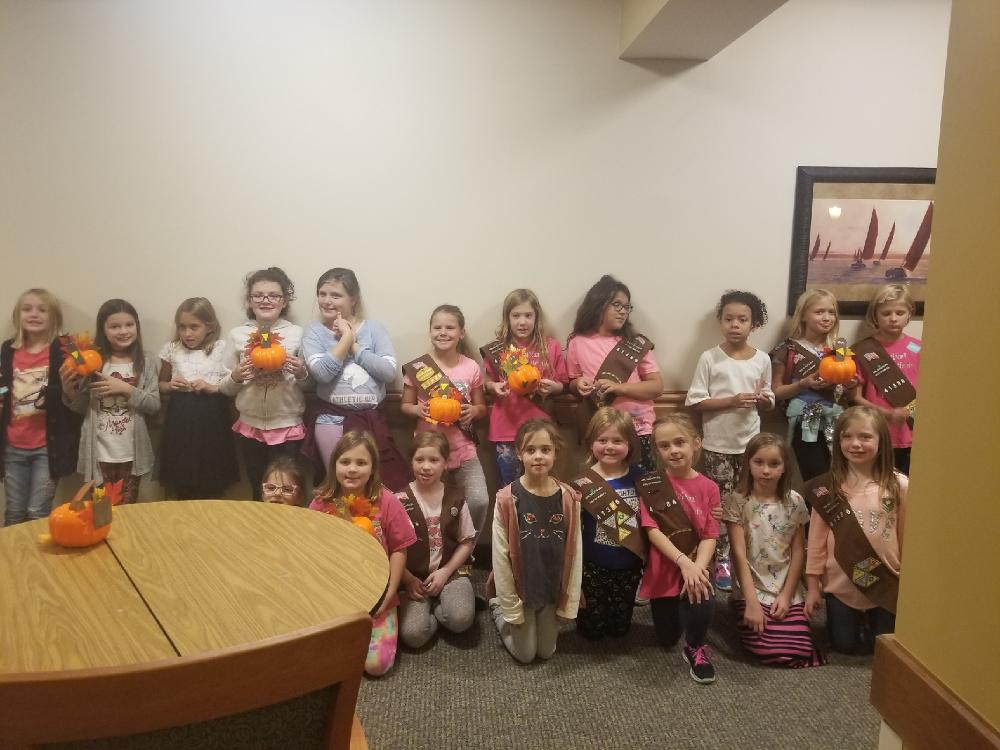 The girl scouts visited The Lighthouse senior living community to create turkey pumpkins with residents