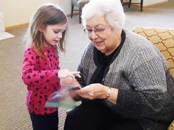 Preschool Children Share Family Photos with Residents