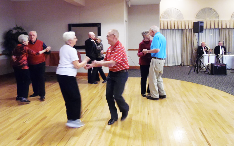 Residents at The Landing dance during a Valentine's Day dance