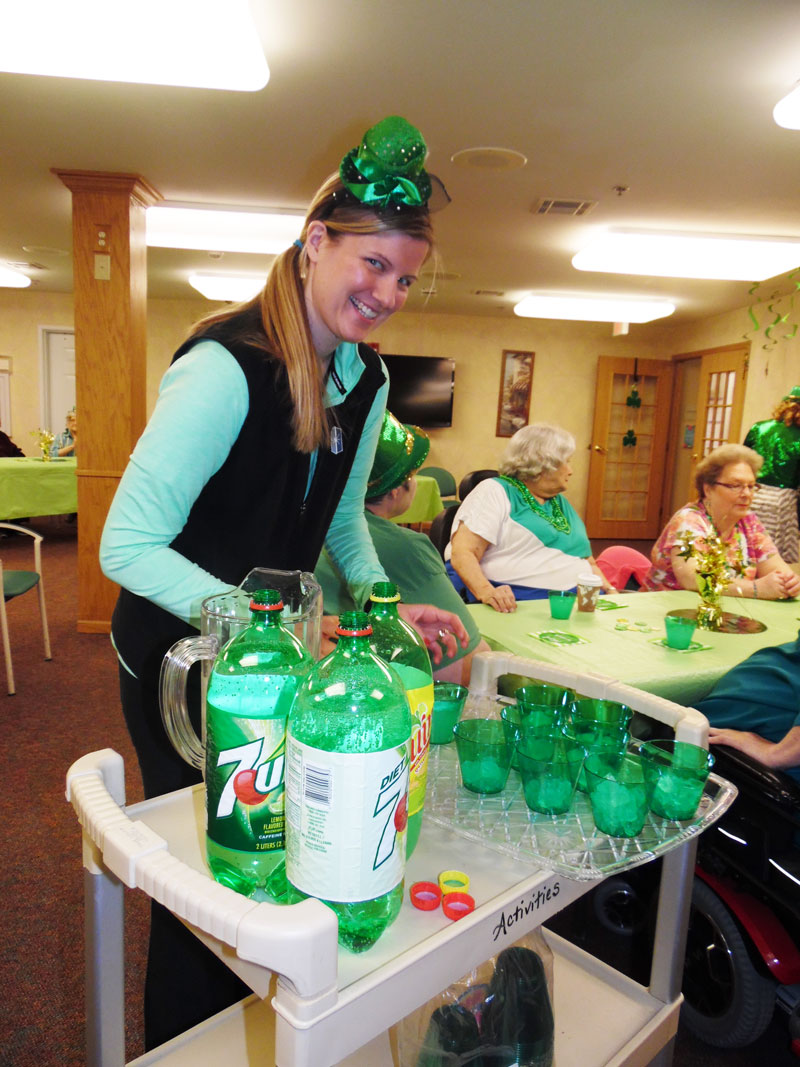 an Immanuel Courtyard employee helps poor some Irish drinks in the form of 7 Up