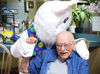 a resident at the arboretum gets a hug from the easter bunny