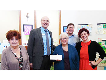 Dellouise Carroll and John Croghan of The Landing in Lincoln, Nebraska present a grant to the Lincoln Arts Council
