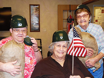 Immanuel Courtyard residents pose in patriotic attire at their USO Show