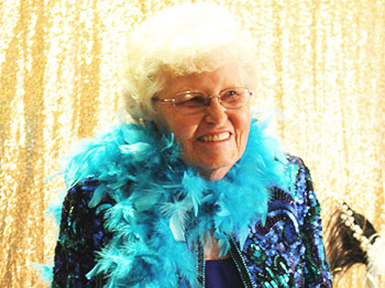 A resident from Immanuel Courtyard poses for a photo at the retirement community's annual prom.