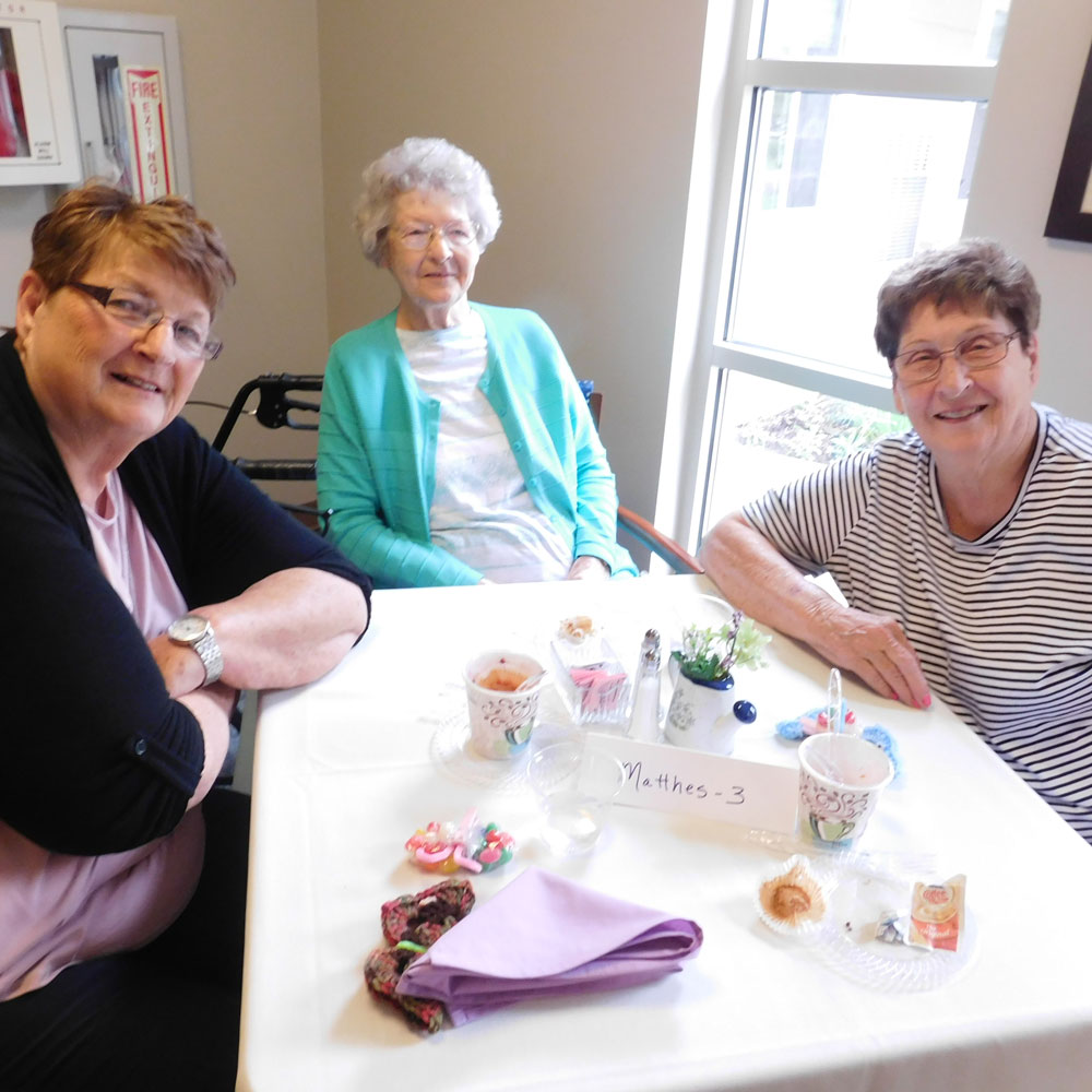 A group of ladies smile for the camera while enjoying conversation at Clark Jeary's Mother's Day Brunch in Lincoln, Nebraska
