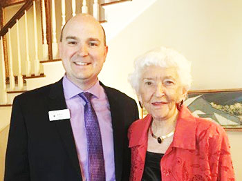 John Croghan, executive director of The Landing, and Alice Dittman, resident of The Landing and former president of Cornhusker Bank, pose together at a fundraising event for the Seniors Foundation.