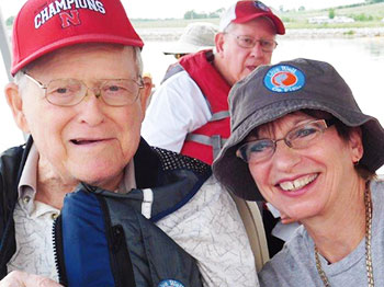 A resident from Clark Jeary, senior living community in Lincoln, Nebraska, smiles big with activities director Beth Alberts while out on a fishing boat at Lake Wanahoo.