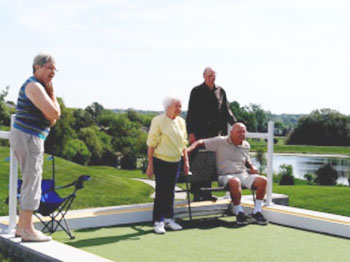 Residents from Pacific Springs Village, and Immanuel Senior Living community in Omaha, Nebraska, face-off in a traditional game of Bocce Ball.