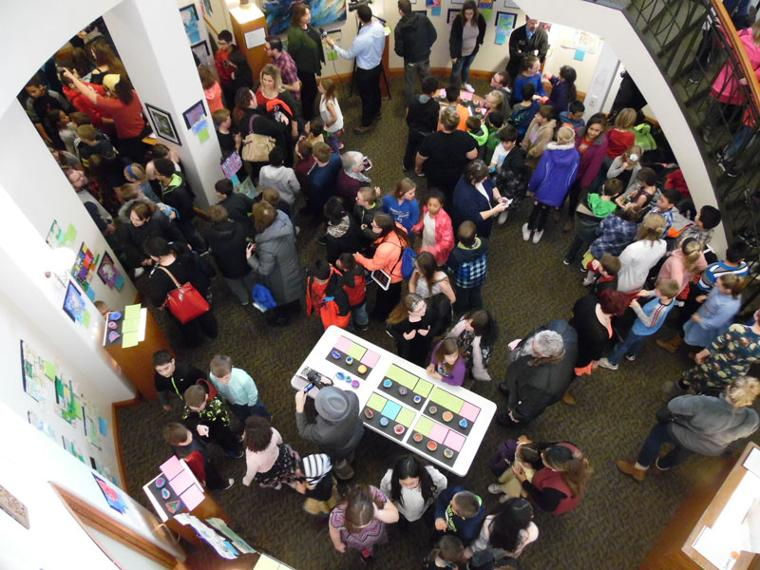 overhead view of elementary school students in the landing's fine arts gallery